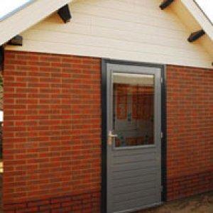 aanbouwen ateliers tuinkamet in stten systeembouw -