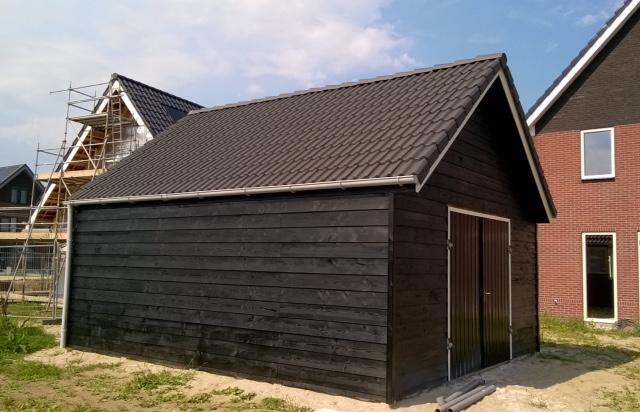 Dubbelwandige beton hout combinatie loods for Photo garage 94